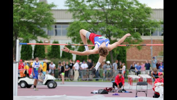 Zach Scholten jumps 6-02 feet Saturday during the Minnesota State High School Track and Field Meet in St. Paul. Scholten earned a fifth-place medal for his effort in the high jump.
