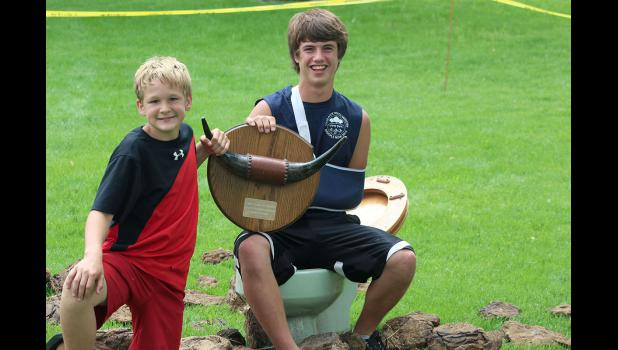 "Zach Bradley (left) and Anthony Malloy formed the winning team, ""Chocolate,"" for the 2015 Buffalo Chip Throwing Contest. Team Chocolate was among 12 registered teams for the annual event, which is organized by the Green Earth Players community theater group."