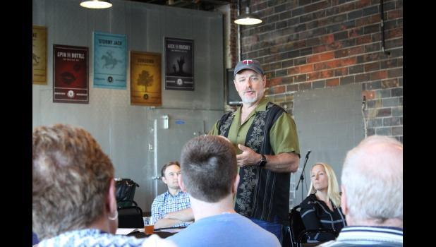 Patrick Gruber, chief executive office of Gevo, Inc., explains plans to use wind turbines to power the Luverne plant to a group of about 30 people, mainly Gevo Luverne employees, June 4 at Take 16 Brewing Co. in Luverne.