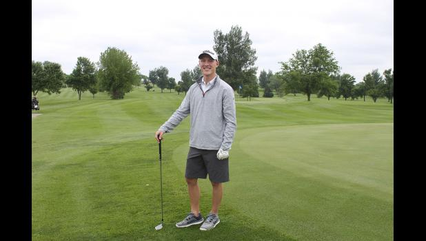 Adam Finke practices before participating in the Hills Friendship Days Golf Tournament at Larchwood Golf Course Friday, June 12. Finke's four-person golf team won first place in the tournament.