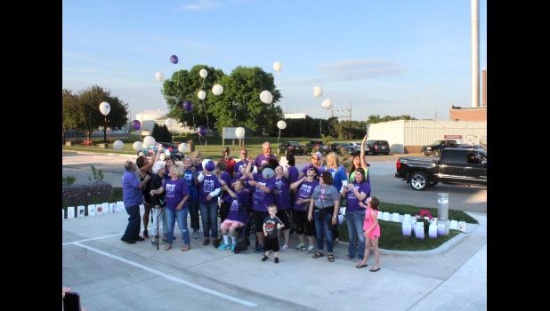 Rock County Relay for Life cancer survivors release balloons at the end of Thursday's Block Party event at Take 16 Brewing Co.