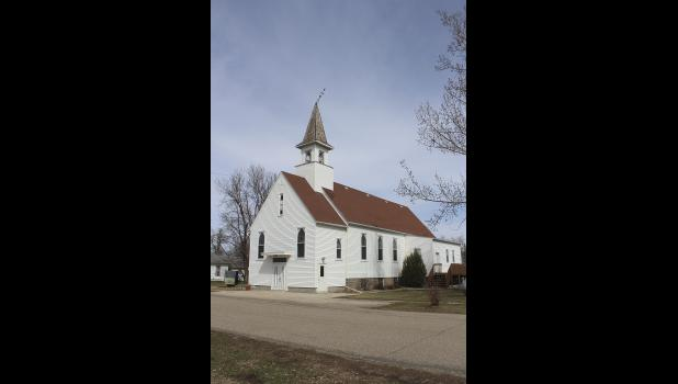 The church in Kenneth dates back to 1894 when congregation members first organized worship services in the Battle Plain school house.