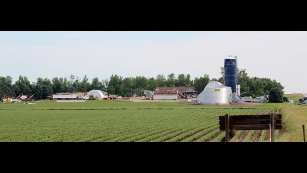 Straight-line winds destroyed a machine shed, enclosed cattle barn and grain bins and damaged the home on LeRoy and Denise Veldkamp farm in northwest Rock County Monday.