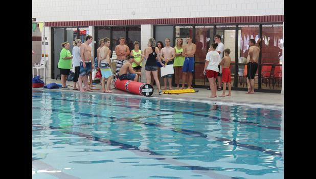 "Carole McNaughton-Commers, a trainer with the Key Log Rolling, Golden Valley, addresses poll staff and interested July 4 volunteers at the pool Wednesday, June 22. ""It is not as easy as it looks,"" she said."
