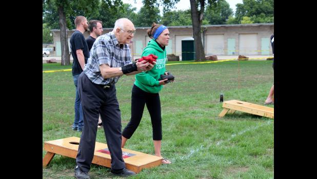Duane Pike and Tanya Stroh take aim in the beanbag tournament at The Lake, aka the creamery pond.
