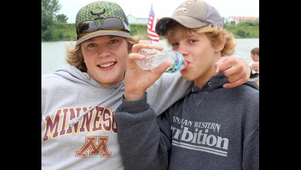 Carson Ehde and Eli Peter Bakken take in the events and activities at the Fourth of July celebration at The Lake.