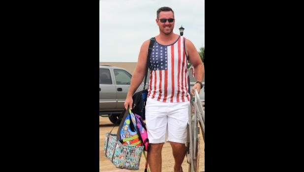 Eric Edstrom heads to the beach with his July 4 gear.