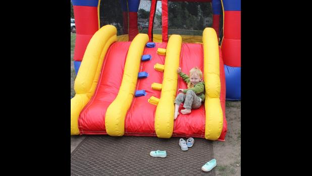 Hank DePiper makes his way down the inflatable slide.