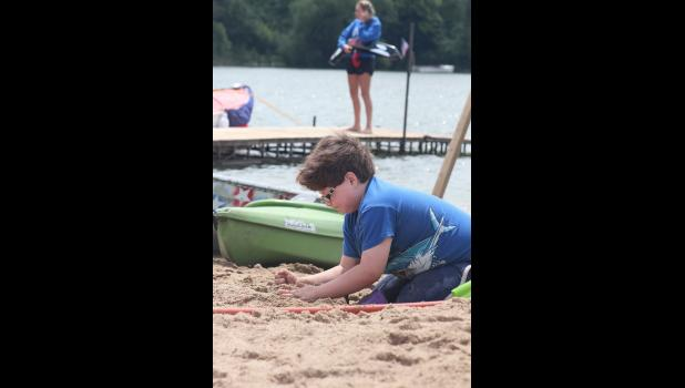 Garret Cattnach gets started on his sandcastle.
