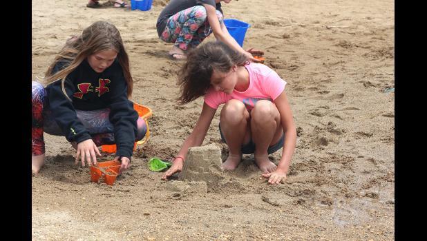 Zakada Bradley (left) and Jordyn Englert work on their sandcastle entry.