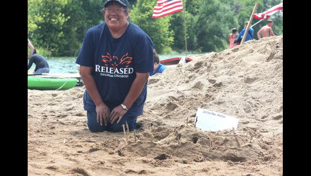 Jennifer Moller was among the first to finish her sandcastle entry.