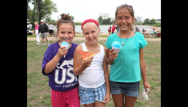 Snow cones and pizza were on the menu for these three girls at The Lake Monday. They are (from left) Jordyn Reisch, Regan Mehlhaff and Inesita Rust.