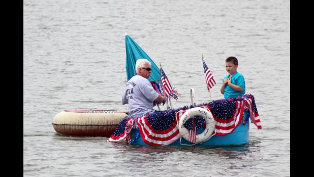 Darrel Ykema and his son, Michael, go for a ride around The Lake prior to the parade.