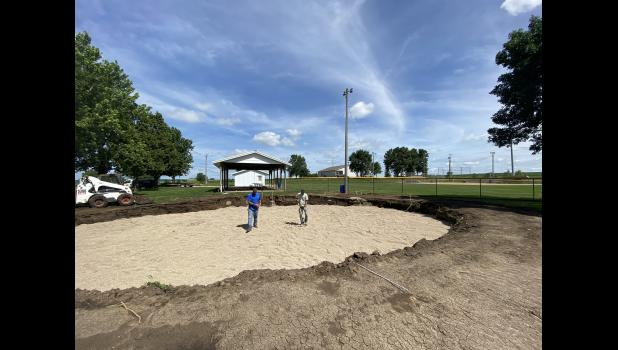 MC&R workers Travis Gallop (left) and Jared Sperle prepare the groundwork, Wednesday, July 1, for Beaver Creek's future community splash pad at the city park near the ball diamonds.