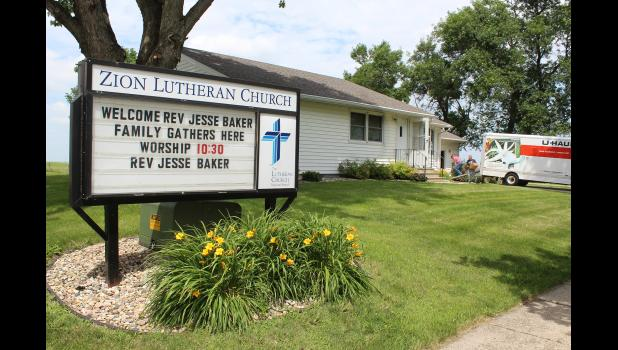Several members of Zion Lutheran Church in Hardwick empty the moving truck for the Rev. Jesse Baker, who will be officially installed as the church pastor in a special 2 p.m. ceremony Sunday.