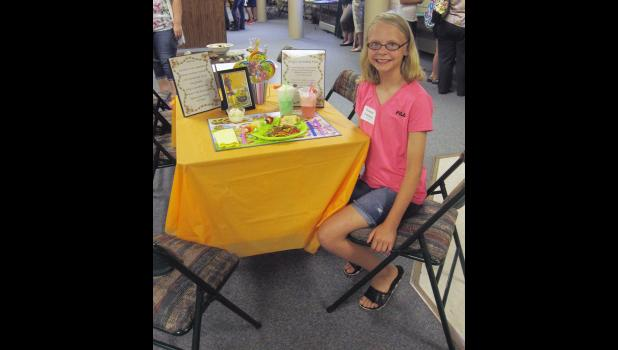 "Danette Leenderts received a grand champion ribbon in food review with a ""Candy Land"" table setting and meal."