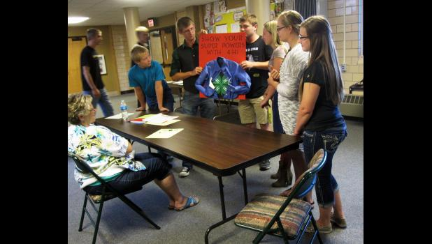 "Members of the Springdell 4-H Club show their idea for a club banner promoting 4-H. Their theme is ""Show Your Super Power with 4-H."" The club received a reserve champion ribbon for their idea."