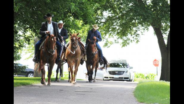 Marty Bonnett (front, left) leads his dad's horse, Hannah, to Maplewood Cemetery in honor of the late Archie Bonnett Monday. Accompanying Bonnett are Scott Wiertzema (back, left) and Wyatt Fey.