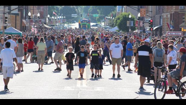 More than 15,000 free hot dogs were grilled and served free of charge Thursday night, July 11, by Luverne merchants and organizations for the hundreds of people who crowded Main Street for the 57th annual event.