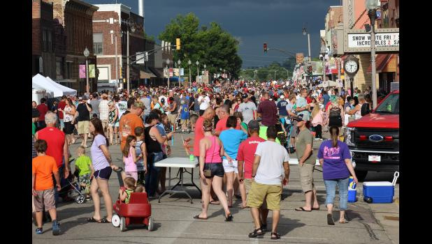 Skies began to darken as thousands gathered Thursday night, July 12, for Luverne's 56th Annual Hot Dog Night. Planned events resumed between showers until a thunderstorm ended outdoor activities around 9 p.m.