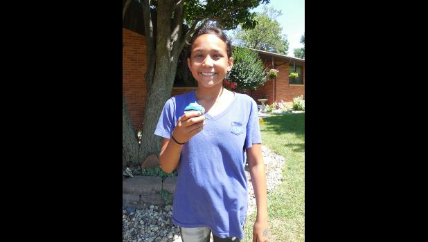 Noemi Cazares won a cupcake during the Cake Walk.  Cupcakes were donated by Glen's Food Center Bakery.