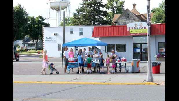 The line starts early at W-2 Quality Meats for Luverne's Hot Dog Night, where more than 15,000 hot dogs were given away by merchants.