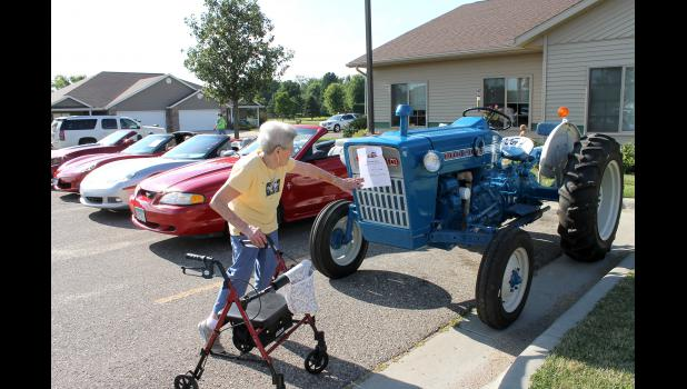 Among the various festivities of Luverne's Hot Dog Night is the classic car show, where Luverne's Marie Klarenbeek takes a closer look at Betty Lorenzen's 1972 Ford tractor.