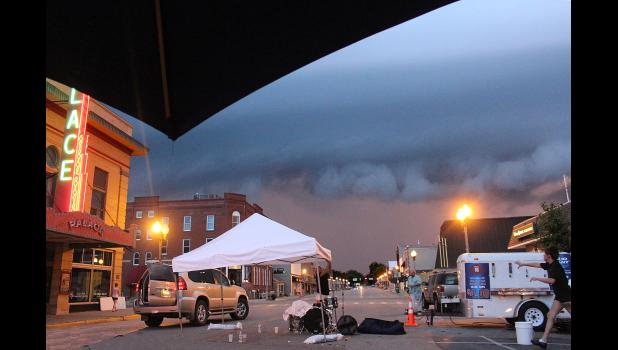 An ominous storm cloud rolls over the city around 9:30 p.m., temporarily suspending Hot Dog Night activities.
