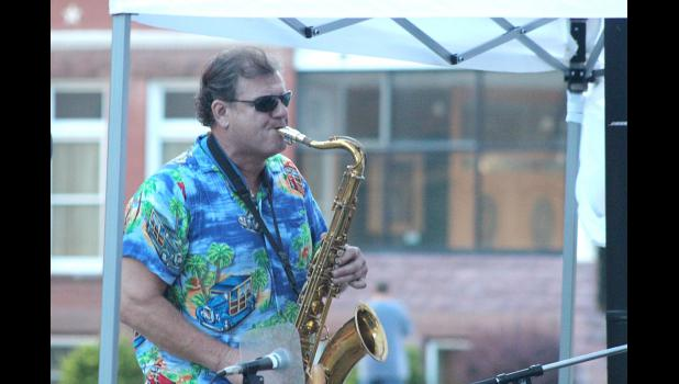 Smooth Groove saxophonist Richard Smith, Sioux Falls, entertains Hot Dog Night listeners on the street outside of Sterling's Thursday night. The group makes regular appearances at Sterling's providing live, light jazz music for restaurant and bar patrons.