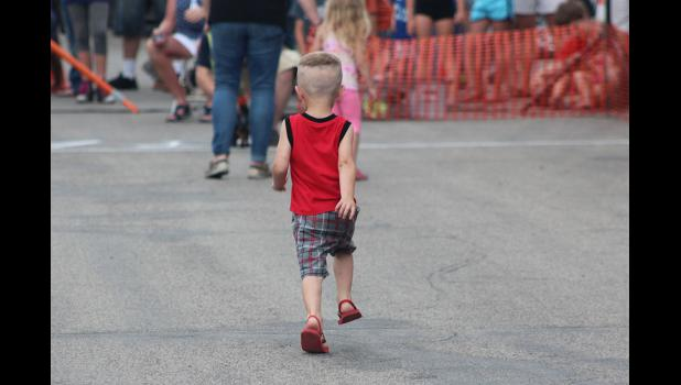 This little human took his own turn on the race track at the Wiener Dog Races Thursday.