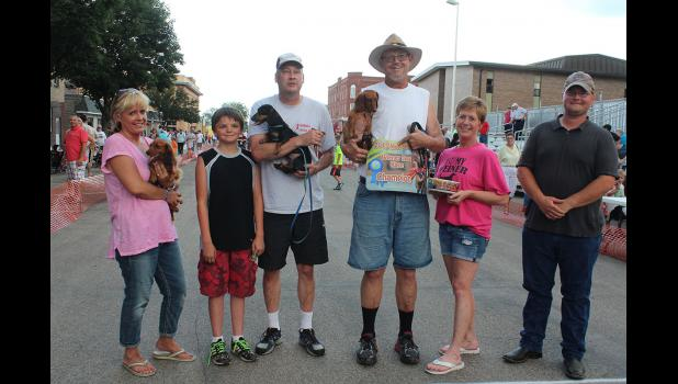 Pictured are the winners of Thursday night's wiener dog races (from left) Misty Kuhnert with Jazzy, Damian Smedsrud and Jon Rust with Calloway and Bob and Tammy Hassebroek with Charlie, who took first place in the 2015 event.
