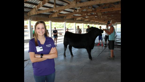 "Rock County Extension Service summer intern Gabryelle Gilliam helped organize an event for this year's fair called ""Mark That Card,"" which allows the public to compare the judge's placings in four different species, including beef. The contest starts Thursday, July 27."