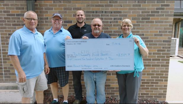 Rock County Food Shelf was a recipient of $8,589.78 from CHS Eastern Farmers. Pictured from left are Tom Nelson, Dan Kindt, Josh Hansen, Carl Gehrke and Food Shelf representative Mary Gehrke.