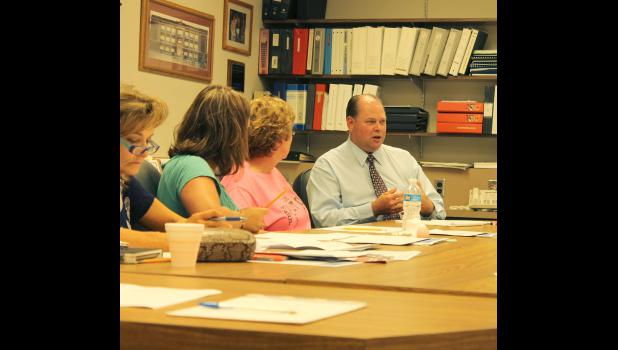 Craig Oftedahl, who began duties as superintendent of Luverne Schools July 1, gives his first report to Luverne School Board members Tuesday, July 21, at the District Office meeting room.