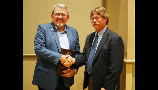 Sen. Bill Weber, Luverne, receives the Legislator of Distinction in Economic Development award on July 26 in St. Paul from Granite Falls Mayor Dave Smiglewski who is president of the Coalition of Greater Minnesota Cities.