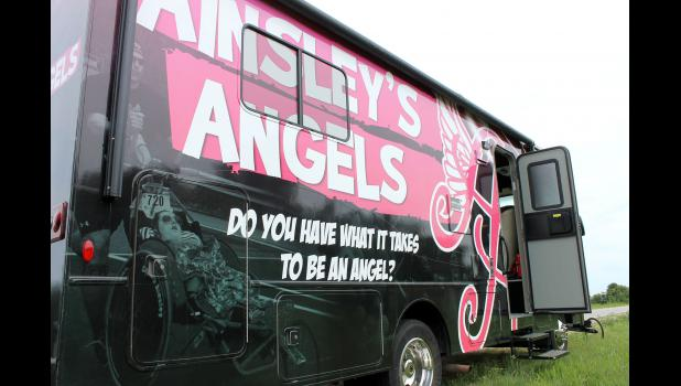 The Evans family uses a recreational vehicle with a picture of Ainsley Rossiter on its side for whom Ainsley's Angels is named. The non-profit organization inspired the family to raise awareness for its mission to promote inclusion and active lifestyles for children with disabilities through a cross country run from Seattle, Washington, to New York City.