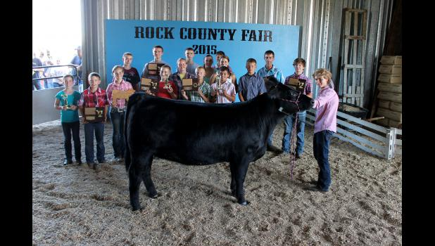 At Saturday night's Parade of Champions, senior beef showman champion Tommy Norman (holding heifer) poses with the beef project award winners. Pictured behind Norman from left are Claire Popkes, Dalton Popkes, Hannah Kruse, Jacob Raak, Matthew Raak, Caleb Raak, Jenna Schelhaas, Joshua Raak, Sean Elbers, Megan Popkes, Trevor Mente, Ellen Dahl, Austin Ossefoort, Dylan Mente, Jared Leuthold and Payton Fick.