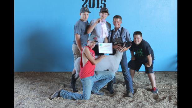 "Friends of Dylan Mente (holding sheep) take partial credit as the ""sheep pit crew"" for Mente's reserve champion intermediate showman performance Thursday afternoon. Pictured from left are Isaac Wiley, Trevor Mente, Payton Fick, Mente and Josh Wiley."