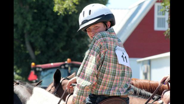 Brody Bonnett looks slyly over his shoulder at the horse arena Friday.