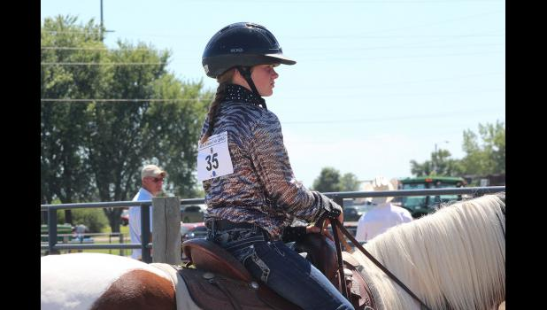 Kennedy Safar waits patiently for her turn in the horse arena Friday.