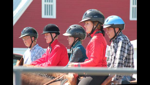 Participants in horsemanship wait for their turn to compete Friday afternoon in the horse arena. Pictured are (from left) Cody Sasker, Adam Fodness, Andrea Severtson, Meranda Fick, and Dean Fuerstenberg.