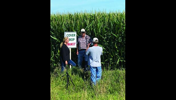 Michael Walgrave (right) films Dawn Madison and Tom Fick talking about cover crops.