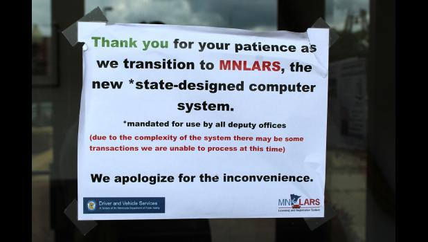 This sign is posted on the Rock County Courthouse door alerting residents of possible delays in the licensing center.