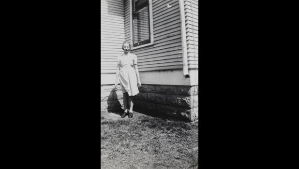 A young Jessie (Ellefson) Wenzel poses outside the south side of her Hardwick home in 1942.