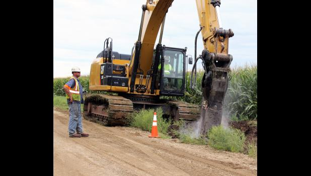 The hydro hammer attached to an excavator makes quick work of jackhammering through a rocky area on 140th Avenue west of the Blue Mounds State Park north of Luverne.