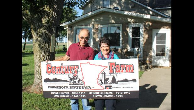 Lloyd and Gladys Hemme hold the sign that designates their farm as a Century Farm, the only Rock County parcel to receive the distinction in 2015.