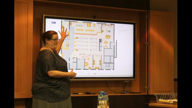Rock County Community Library Director Serena Gutnik explains renovation plans at the Aug. 18 county commissioner meeting.