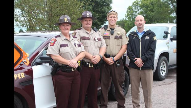 Minnesota State Patrol Trooper Lori Halsne (left) Lt. Matt Sorenson, Rock County Deputy Dallas Hamm are pictured with Brad Bigler (far right. Bigler's family was killed in a drunk driving crash and he spoke at Friday's event on I-90.
