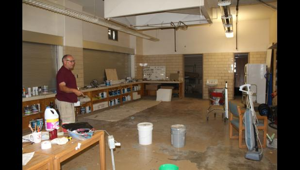Dave Meyer, who oversees the grounds of the City Center Apartments, uses the former kitchen area of the elementary school as a maintenance office.