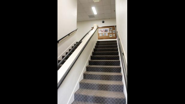 Carpet has been laid throughout the former elementary school, but the apartment building still features the original staircases, wide halls and tall ceilings.